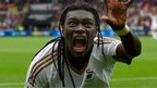 Swansea striker Bafetimbi Gomis celebrates after scoring the second swansea goal during the Barclays Premier League match between Swansea City and Manchester United on August 30, 2015 in Swansea, United Kingdom.