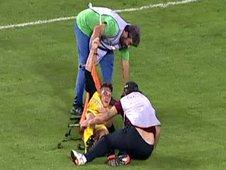 Ergotelis' Leonardo Koutris is dropped to the floor by two stretcher-bearers