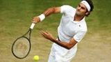 Roger Federer serving at Wimbledon