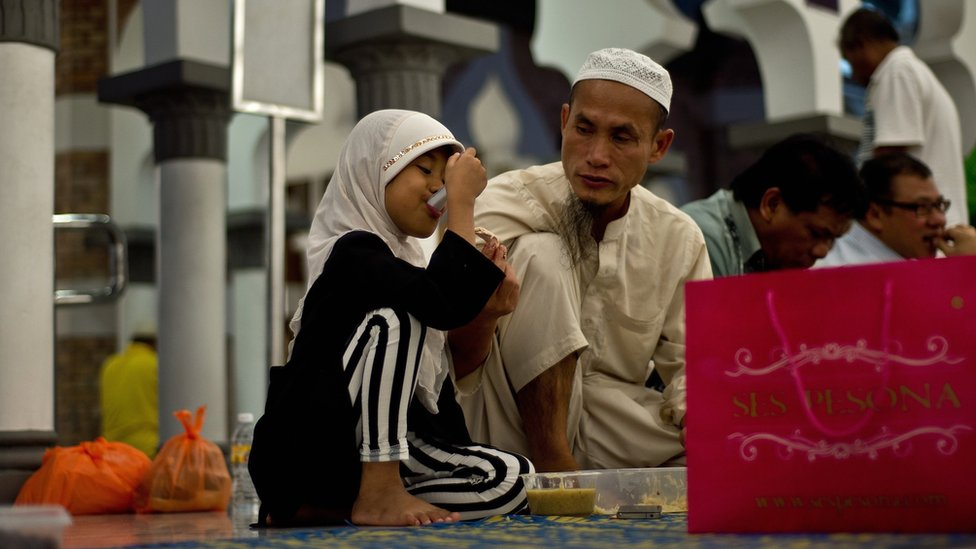 A Muslim girl in Malaysia breaks her fast during the holy month of Ramadan.
