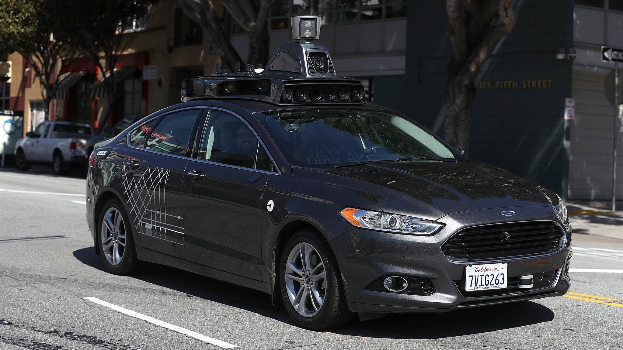 Uber halts self-driving car tests after death