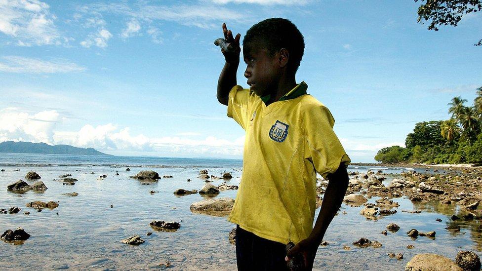 Solomon Islands boy at beach
