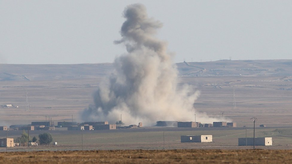 Explosion after an air strike by a US-led coalition warplane on an Islamic State position near al-Hawl, Syria (10 November 2015)