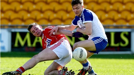 Cork's Kevin Flahine is challenged by Monaghan opponent Conor McCarthy in the U21 semi-final