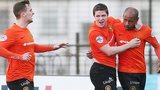 Miguel Chines (right) celebrates scoring against Ballymena