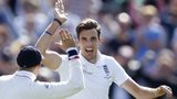 Steven Finn celebrates a wicket with Joe Root