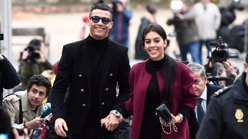Ronaldo all smiles on way to court