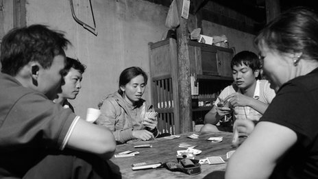 Photo of people playing cards
