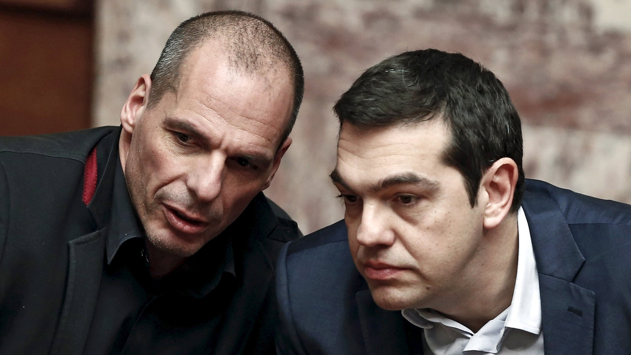 "Greek Prime Minister Alexis Tsipras defends his former finance minister in a row over an ""emergency plan"" in case of Greece's exit from the euro."