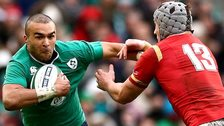 Ireland's Simon Zebo in action against Jonathan Davies of Wales
