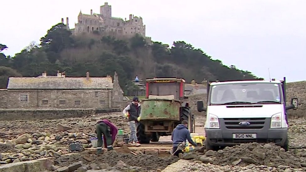 Builders working on the causeway