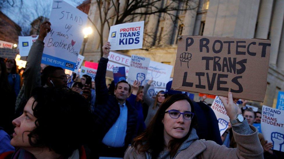 Trump rescinds transgender bathroom rules from Obama era