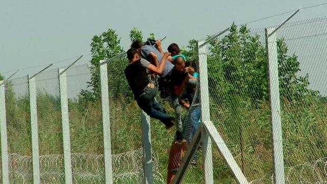 VIDEO: Migrants breach razor wire fence in Hungary...