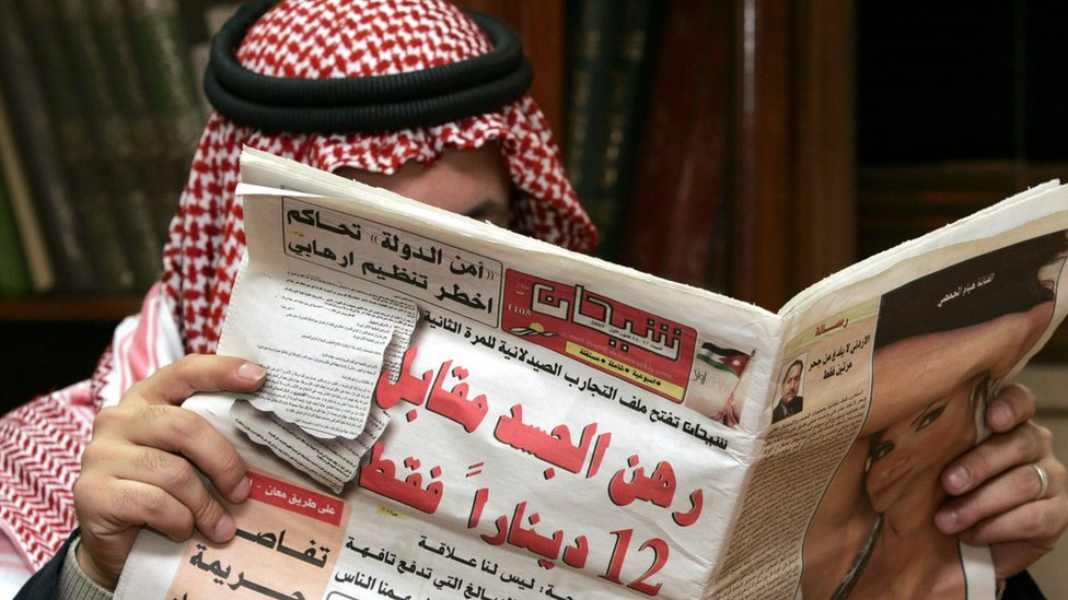 Jordanian man reading paper