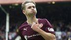 Sam Nicholson celebrates Hearts' winning goal