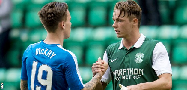 Rangers' Barrie McKay shakes hands with Scott Allan in a match against Hibs