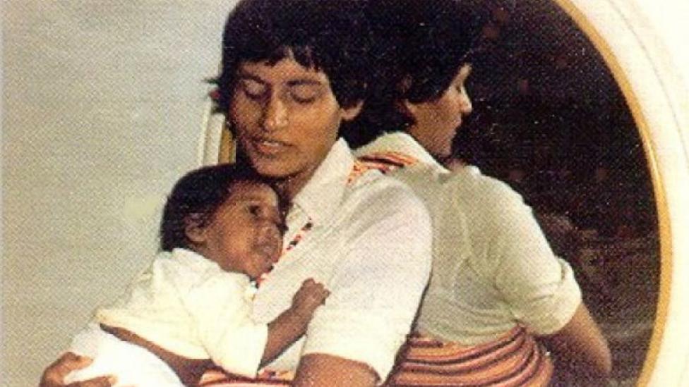 João Ernesto Van Dunem as a baby in 1977 being held by his mother Sita Valles