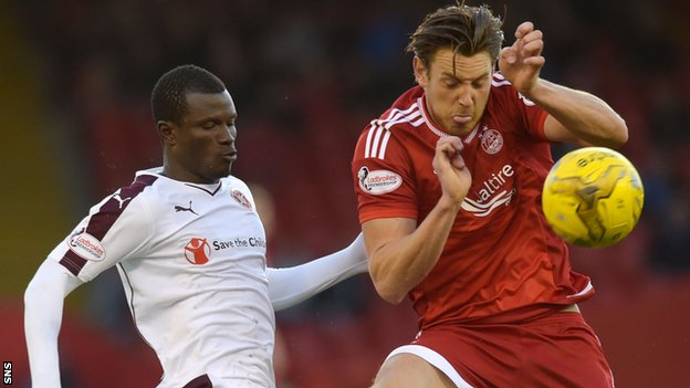 Hearts' Abiola Dauda challenges for the ball with Aberdeen's Ash Taylor