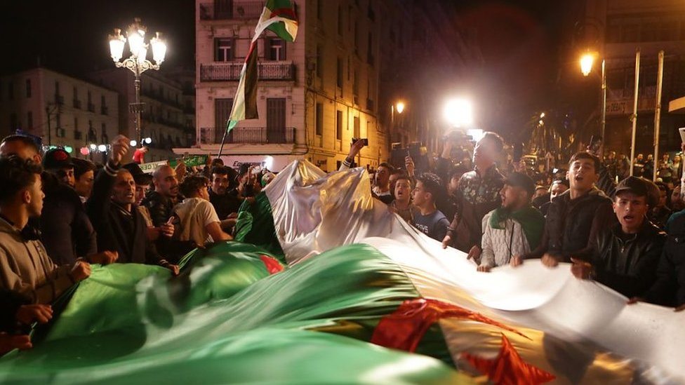 Algerians celebrate after president Bouteflika resigned