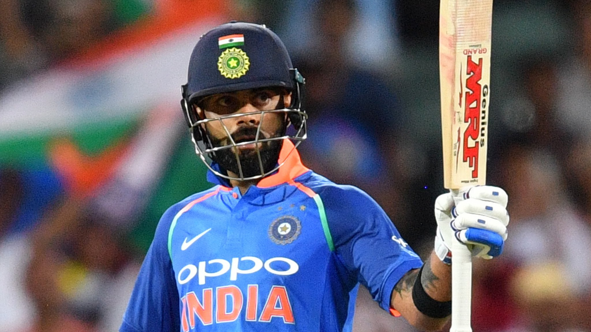 Kohli and Dhoni shine as India beat Australia
