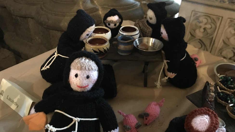 Knitted monks go on show in Tewkesbury Abbey