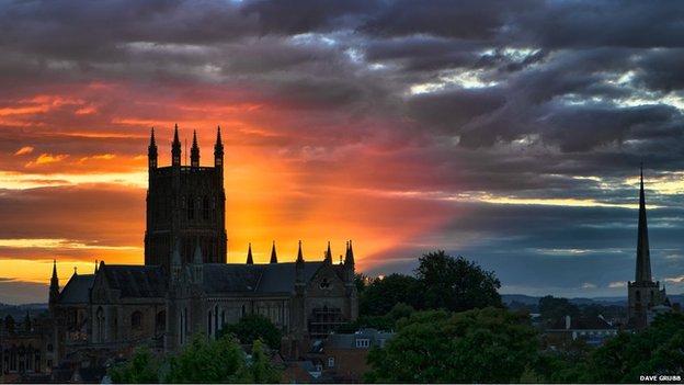 An orange sunset by a church
