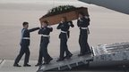 The coffin of Lisa Graham is taken from the RAF C-17 carrying the bodies of nine British nationals killed in the Tunisia terror attack at RAF Brize Norton in Oxfordshire