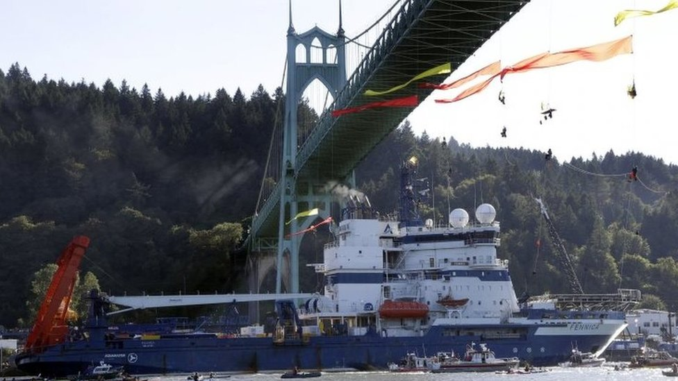 Greenpeace protesters are removed from a bridge in Portland, allowing an icebreaker to leave to join an Arctic oil drilling operation.