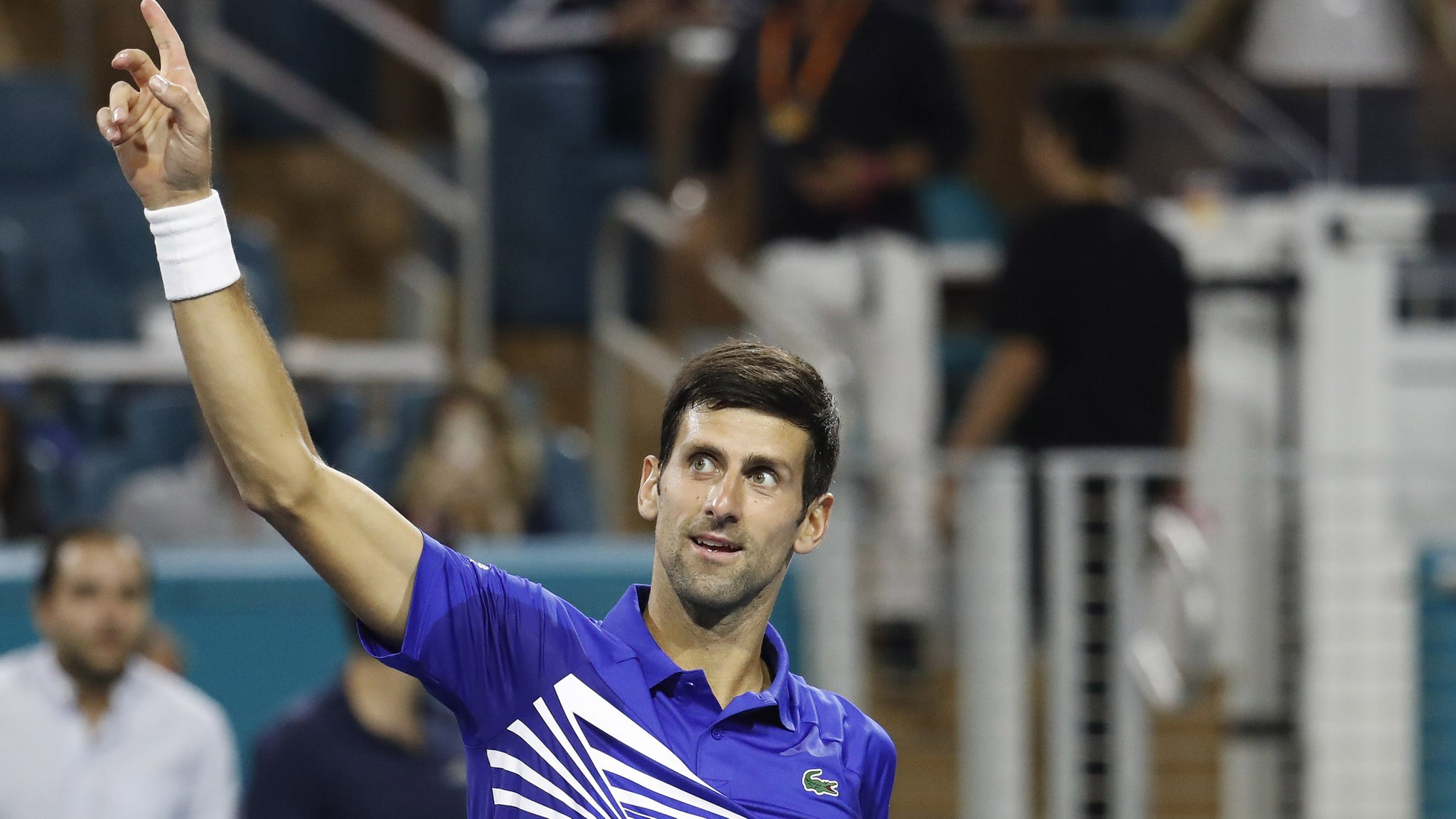 Djokovic beats Tomic in Miami in bid for record seventh title