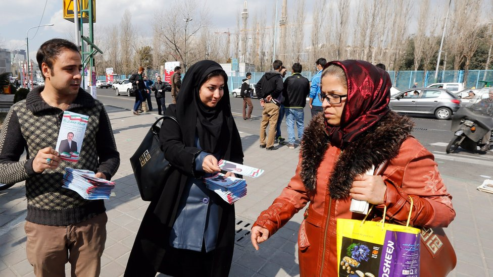 Iranian election campaign workers distribute election information of candidates of parliamentary and the Assembly of Experts elections in a street of Tehran, 19 February 2016.