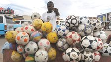 A football vendor in Angola