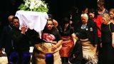 Jonah Lomu's family follow his casket at the service
