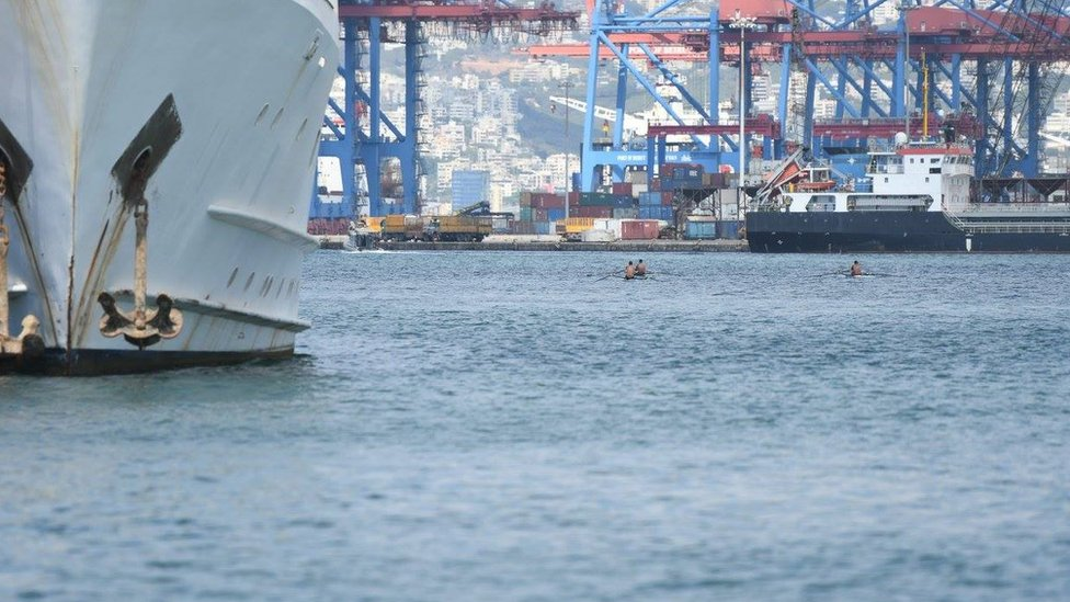 Rowers next to the port