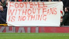 Liverpool fans hold up a banner during the game against Sunderland