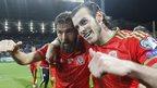 Gareth Bale (r) and Joe Ledley (l) celebrate after the match