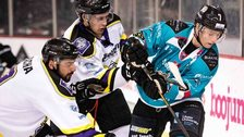 Two Manchester Storm players challenge Giants opponent Mark Garside