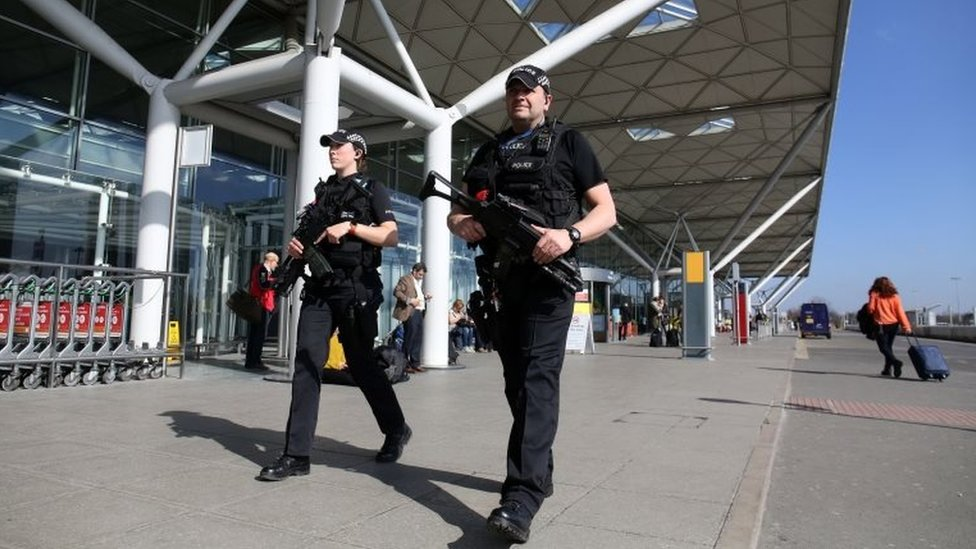 Armed police at Stansted Airport, Essex