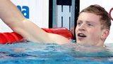 Adam Peaty celebrates in the pool
