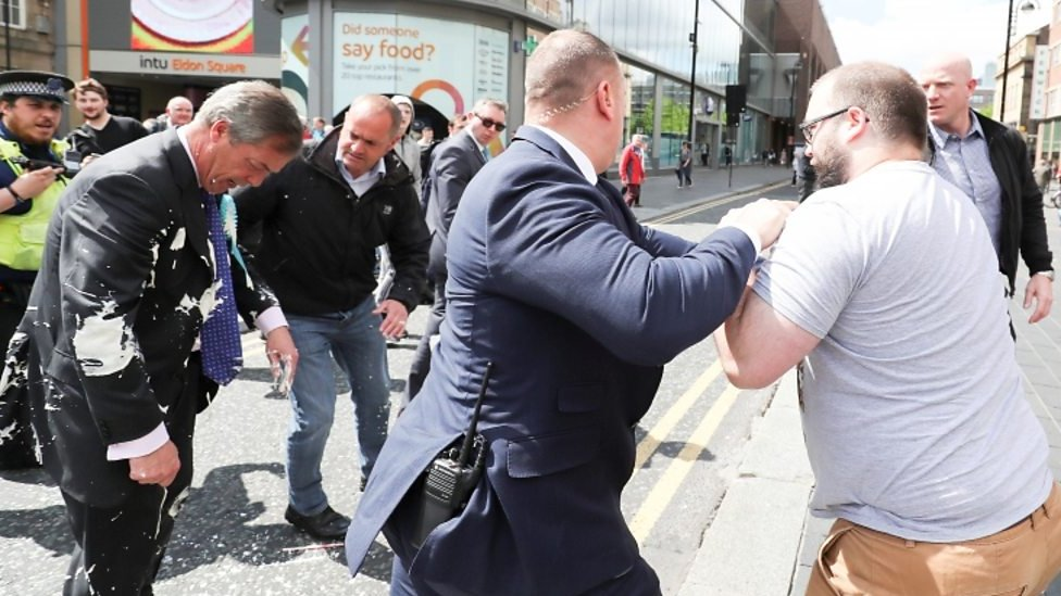 The moment Farage is hit by a milkshake