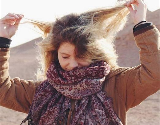 Female tourist in Iran removing her hijab