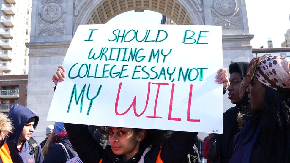 """""""I should be writing my college essay, not my will"""" reads a student's sign in New York"""