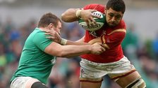 Taulupe Faletau is tackled by Jack McGrath