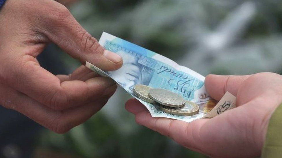 Household squeeze shows signs of easing as wages rise
