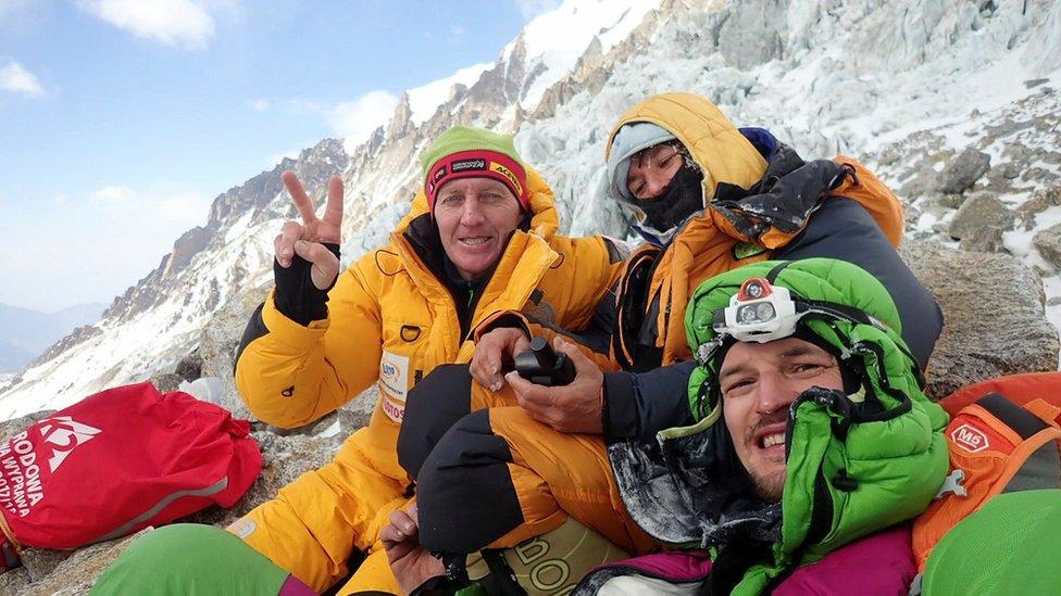 Russian climber Denis Urubko, French climber Elisabeth Revol, and Polish climber Adam Bielecki pose for a picture at the base of the Nanga Parbat on 28 January
