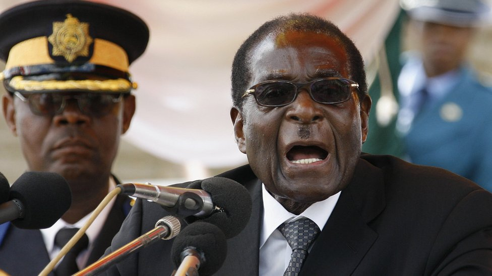 May welcomes Zimbabwe's 'brighter future' after Mugabe