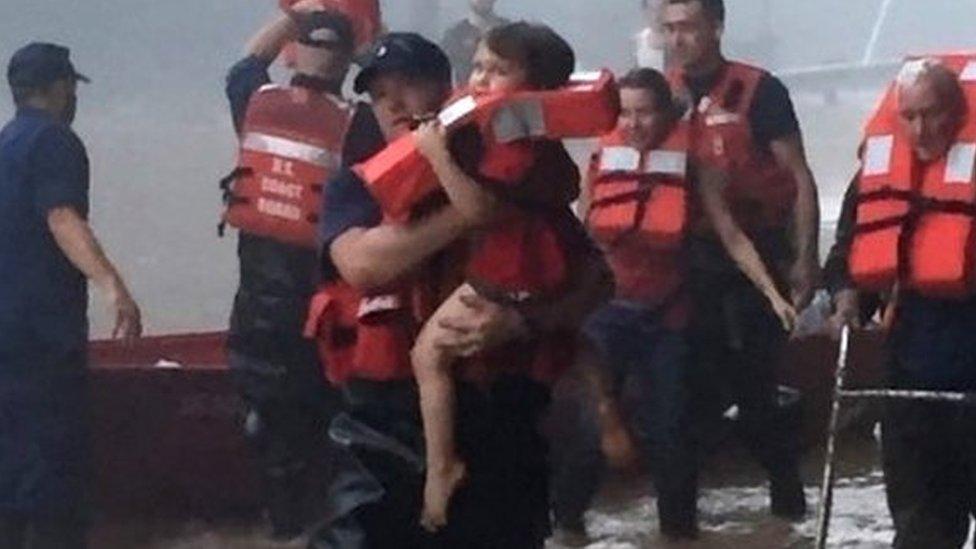 US flood survivor 'clung to dead husband'