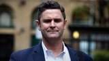 Chris Cairns outside court on 24 November