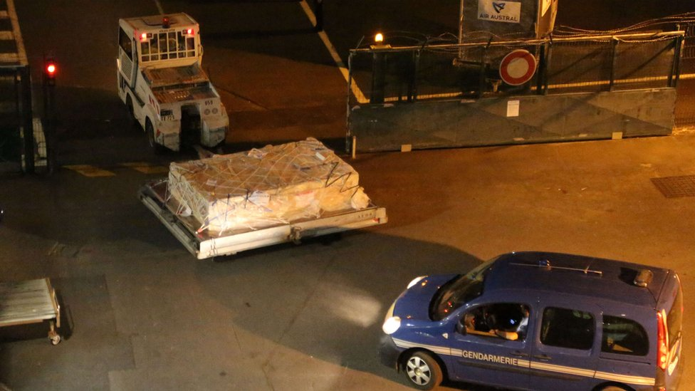 A piece of debris that experts believe could be from missing flight MH370 arrives in Paris from Reunion in the Indian Ocean for analysis.