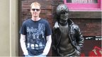 Writer of John Lennon's Last Day, Stephen Kennedy, next to the John Lennon statue outside the Cavern in Liverpool
