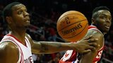 Terrence Jones of the Houston Rockets battles for the basketball with Jerami Grant of the Philadelphia 76ers